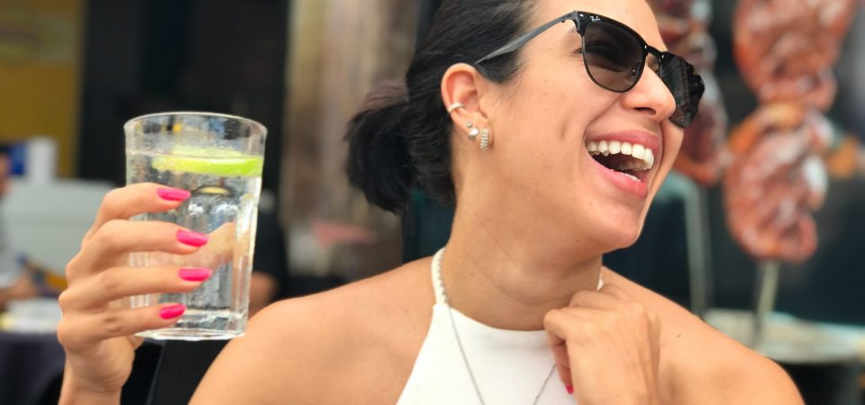 woman-laughing-drinking-water